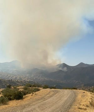 Fire crews continued to battle the Habanero Fire which has burned about 3,400 acres southwest of Globe, officials said Friday, Oct. 23, 2020.