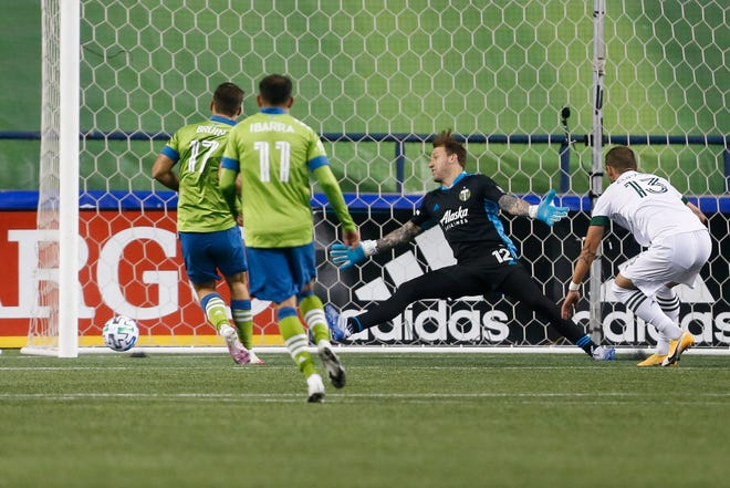 Seattle Sounders FC forward Will Bruin (17) scores the equalizing goal against the Portland Timbers during the second half at CenturyLink Field.