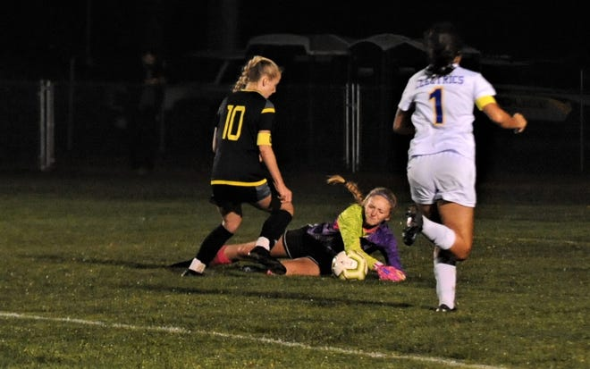 Philo keeper Kierston Harper makes a save on a shot by Tri-Valley's Claire Martin in the second half on Thursday's Division II sectional final. Martin scored the game-winner in overtime, as the Scotties won 2-1.