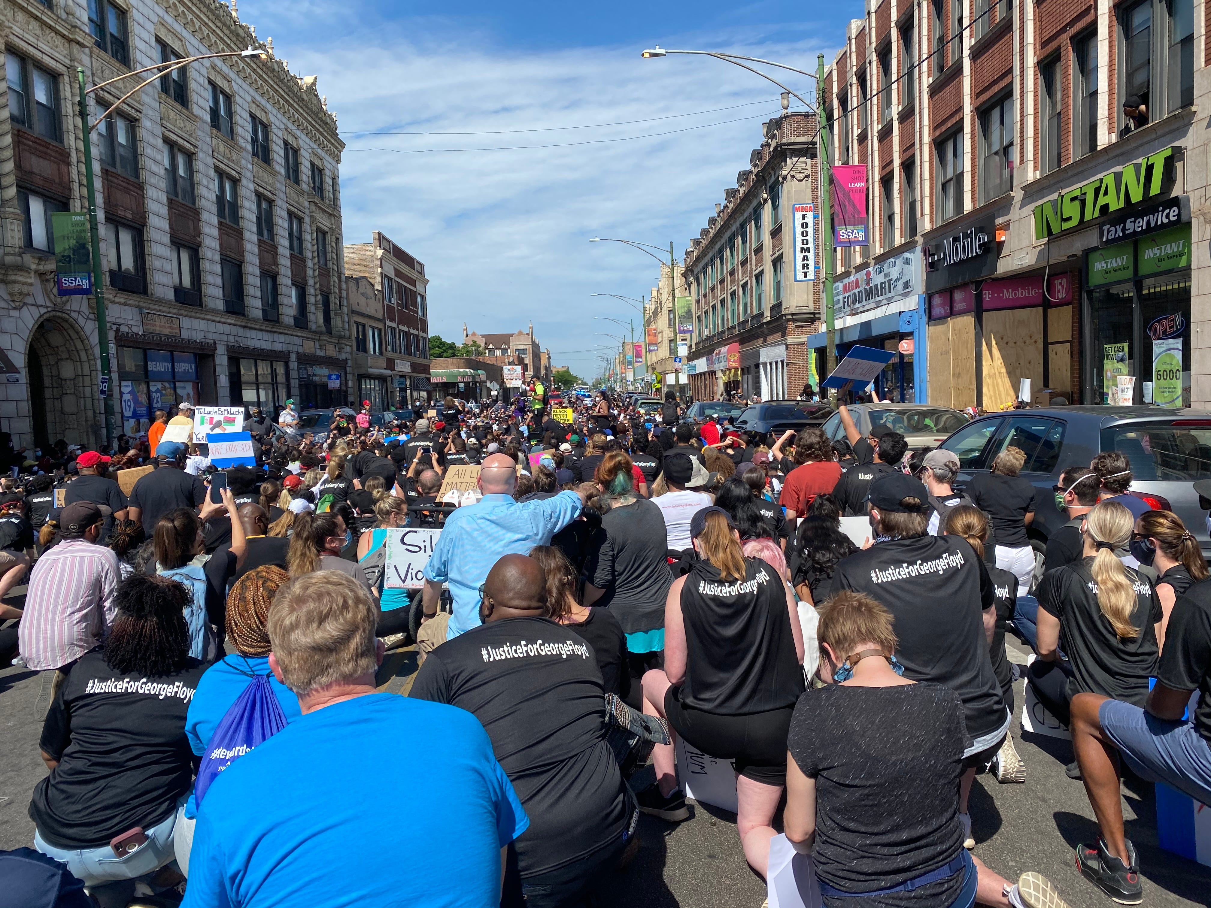 """Hundreds of people take a knee at a """"Peace Walk"""" in Chicago's South Side Chatham neighborhood on June 7, 2020."""