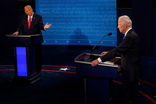 President Donald Trump gestures toward Democratic presidential candidate former Vice President Joe Biden.