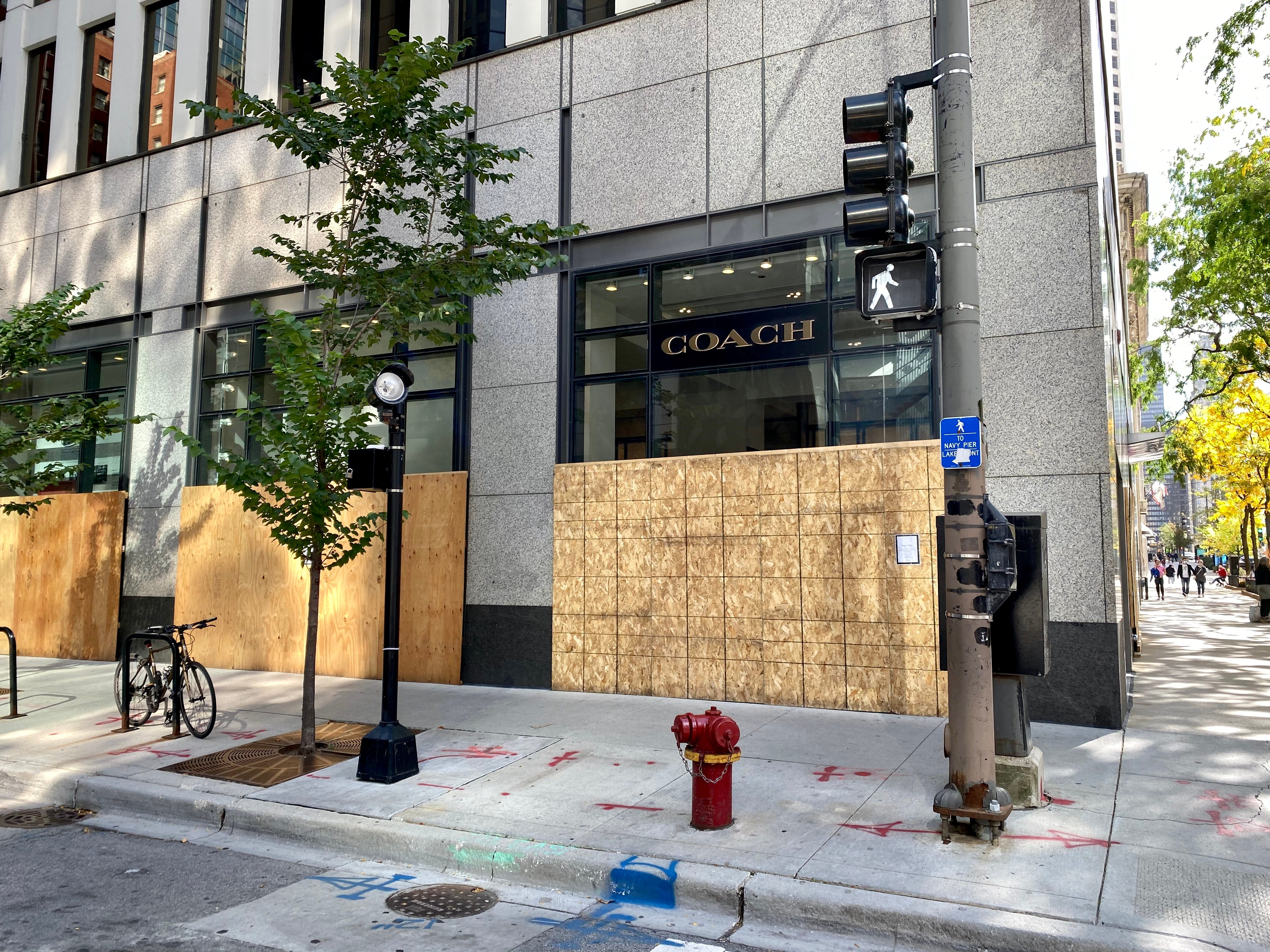 Dozens of storefronts in downtown Chicago remain boarded on Oct. 14, 2020.