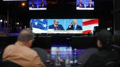 People are pictured watching the final debate between President Donald Trump and Democratic presidential nominee Joe Biden at The Abbey in West Hollywood, California.