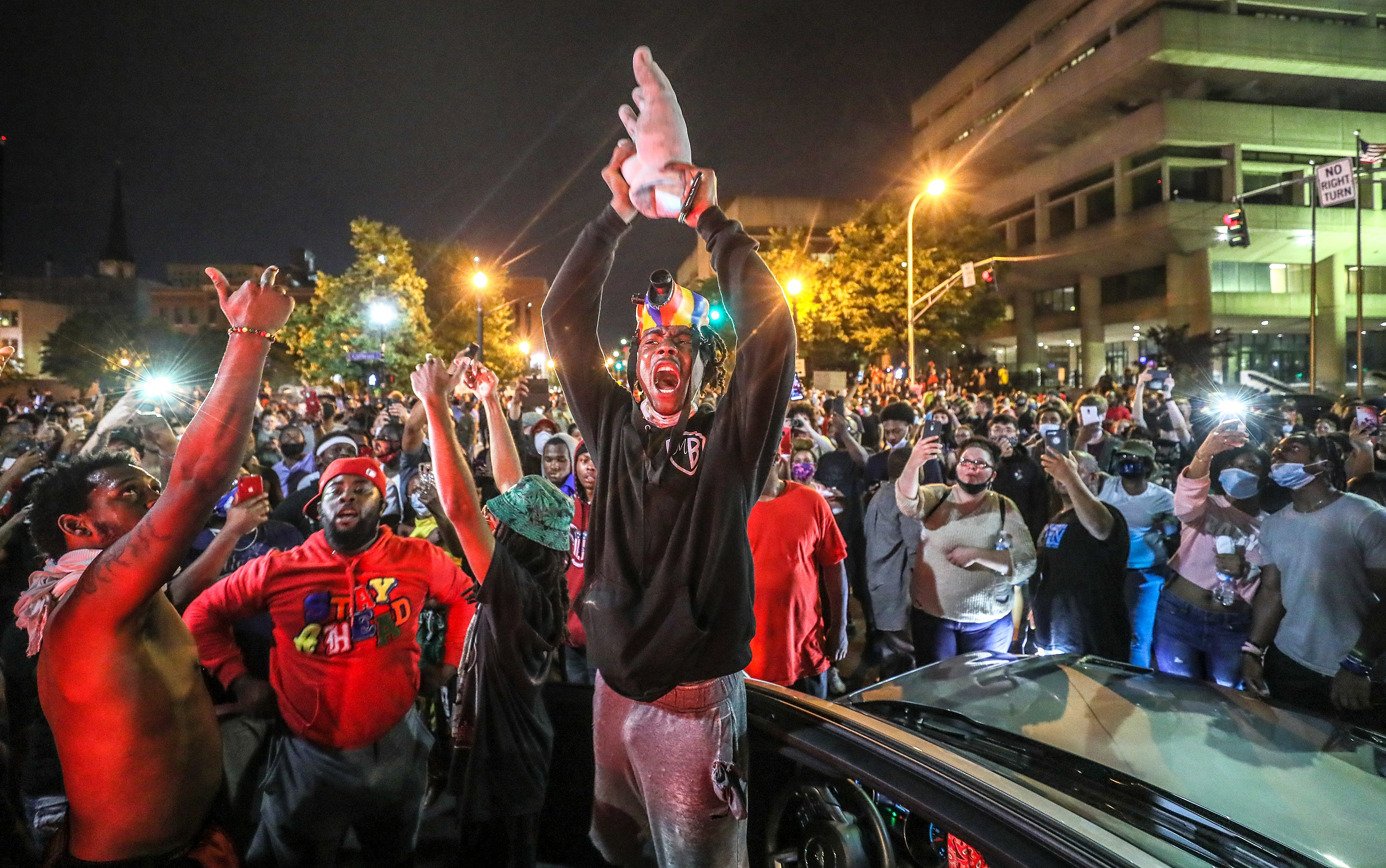 A protester holds up the hand of King Louis XVI after it was torn from the statue during a demonstration on Thursday, May 28, 2020. Louisville broke into protests following the murder of Breonna Taylor.