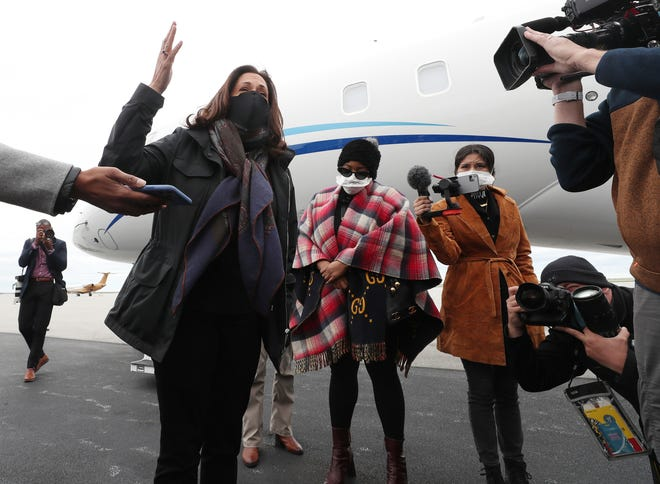 Democratic vice presidential candidate Sen. Kamala Harris, D-Calif., greets reporters on her arrival at Burke Lakefront Airport during a campaign visit  to the Cleveland area Saturday.