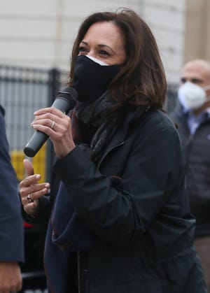 Democratic vice presidential candidate Sen. Kamala Harris, D-Calif., thanks voters for waiting in line to vote outside of the Cuyahoga County Board of Elections during a campaign visit in Cleveland on Saturday.