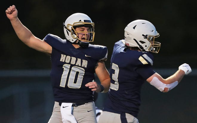 Hoban quarterback Shane Hamm, left, celebrates after connecting with receiver Brayden Fox, right, on a 26-yard touchdown pass against Mayfield during the first half of a Division II playoff game on Oct. 23.