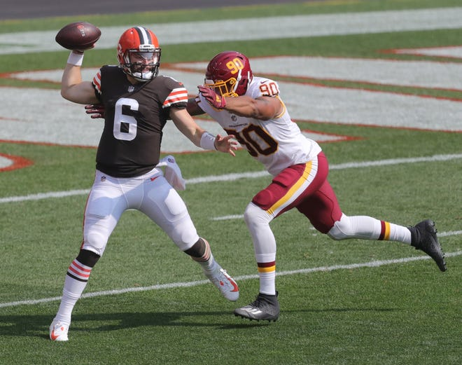 Browns quarterback Baker Mayfield faces pressure from Washington's Montez Sweat on Sept. 27 in Cleveland. The Browns won 34-20.