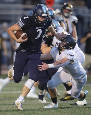 Hudson's Aiden Lal stiff arms Painesville RiversideÕs Matthew Spofford during a first quarter run in a Division I playoff game at Murdough Field on Friday, Oct. 23, 2020 in Hudson, Ohio. [Phil Masturzo/ Beacon Journal]
