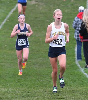 Ana Crangle of Tallmadge, right, and Lauren Mahoney of Hoban run during the Division II District Cross Country meet last month.