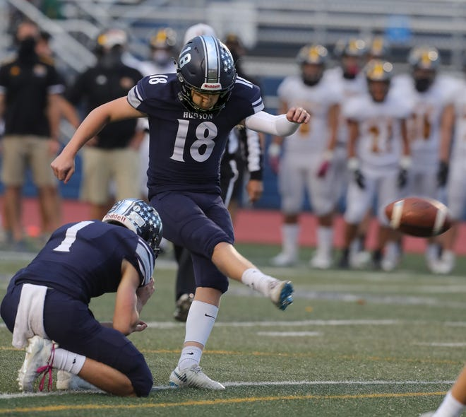 Hudson kicker Jake Vidmar kicks the record-breaking extra point in the first quarter against Painesville Riverside in a Division I playoff game at Murdough Field on Friday, Oct. 23, 2020 in Hudson, Ohio. [Phil Masturzo/ Beacon Journal]
