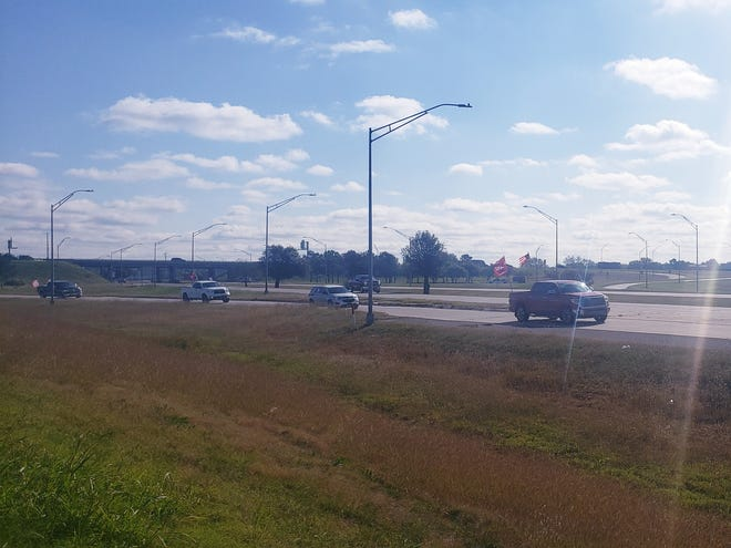 A group of vehicles exits the interstate on Saturday during the Drive for 45 parade.