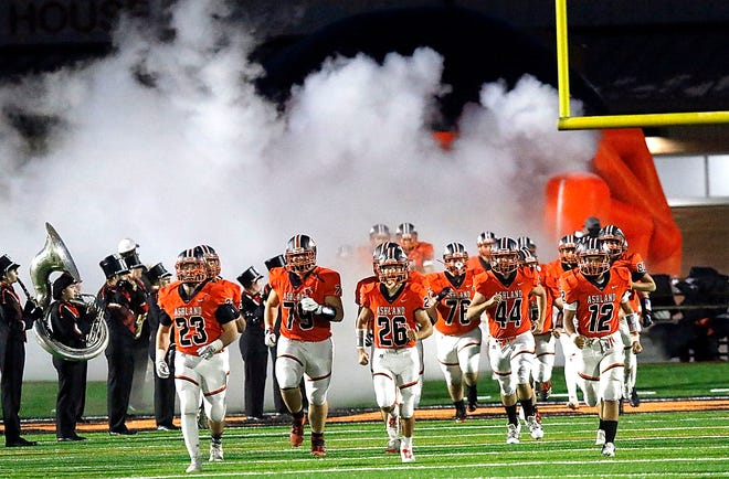 Ashland High School's football team takes the field for the game against Norwalk High School during their third round OHSAA Division III football playoff game at Community Stadium on Friday, Oct. 23, 2020. TOM E. PUSKAR/TIMES-GAZETTE.COM