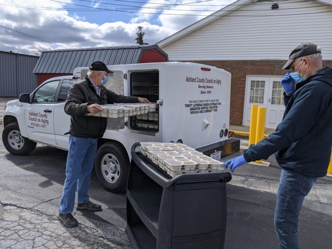 Ashland County Council on Aging employees fill a vehicle with meals to deliver to senior citizens throughout the county. Home delivered meals is one of the many services the Ashland County Council on Aging offers.