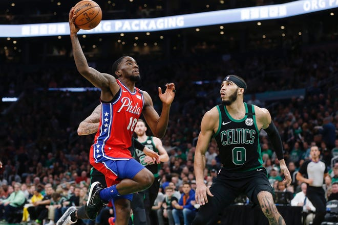 The Sixers' Shake Milton drives to the basket on the Celtics' Jayson Tatum during the 2020 NBA playoffs.