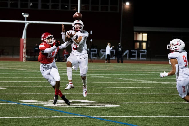 Lenape's Trevon Rice (3) intercepts a ball intended for Rancocas Valley's Treyvon Corchado (87) Friday, Oct. 23, 2020 in Mount Holly, N.J.