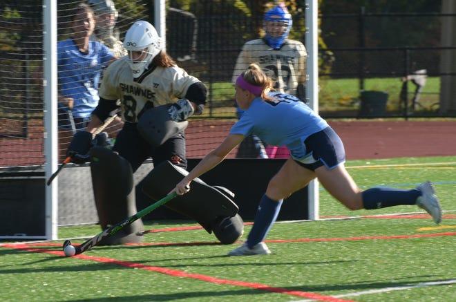Shawnee senior Tori DiGennaro gets her stick on a ball during pregame warmups against Moorestown.