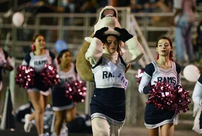 Rochester High School cheerleaders and the mascot evacuate the stadium before their game against Shenango Friday night because of an active shooter situation nearby.