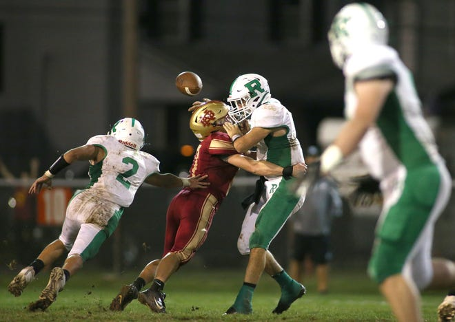New Brighton's Dashawn Harmon (7) sacks Riverside quarterback Samual Hughes (1) resulting in a fumble during the first half Friday night at Oak Hill Field in New Brighton.