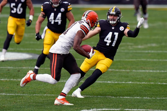Cleveland Browns wide receiver Donovan Peoples-Jones tries to get past Pittsburgh Steelers linebacker Robert Spillane (41) during an NFL football game Oct. 18, 2020, in Pittsburgh. Spillane carved out a roster spot on the Steelers by becoming a special teams ace. He officially has a new title: the replacement for injured linebacker Devin Bush, who is out for the season after tearing the ACL in his left knee.