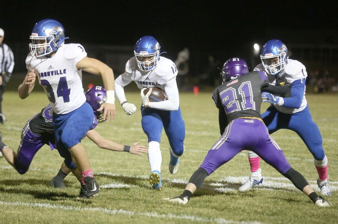 Boonville junior Jamesian McKee (13) runs the ball during a game against Hallsville on Friday night at Hallsville High School.