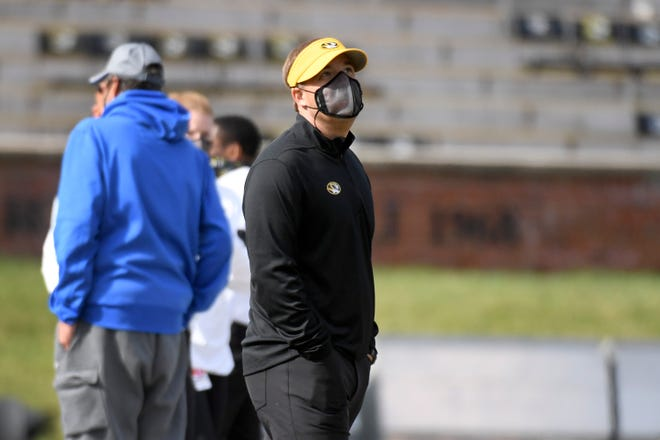 Missouri head football coach Eli Drinkwitz roams the field before the start of a game against Kentucky on Saturday at Faurot Field.