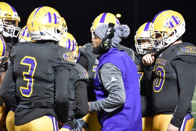 Hickman head football coach Cedric Alvis speaks to a group of his players during a game against Jackson on Friday night at Hickman High School.