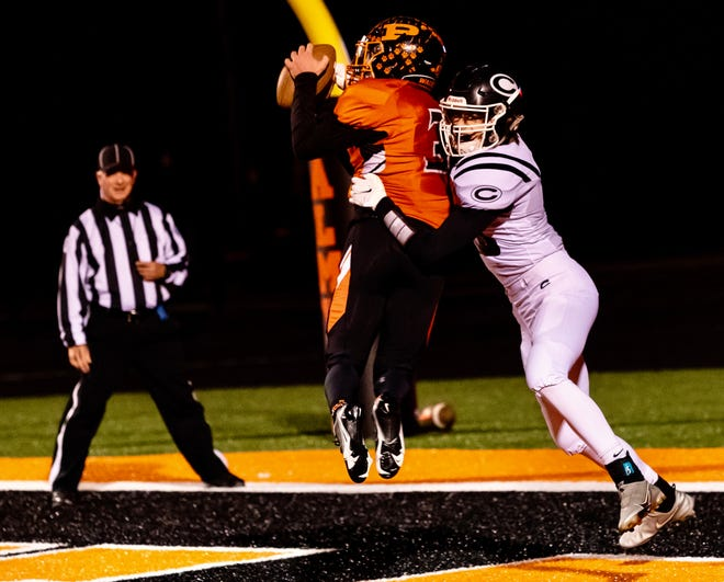 Palmyra's Landyn Smith (3) makes an interception in the end zone against Centralia during a game Friday night at Palmyra High School.