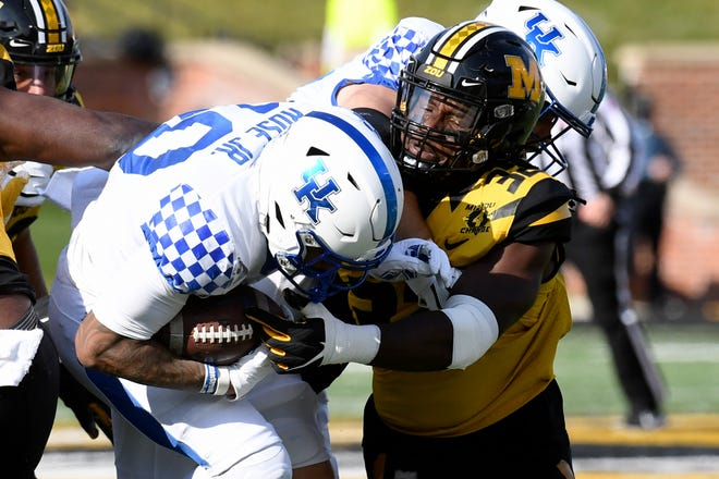 Missouri linebacker Nick Bolton, right, reaches for Kentucky running back Asim Rose Jr. during a game Saturday at Faurot Field.