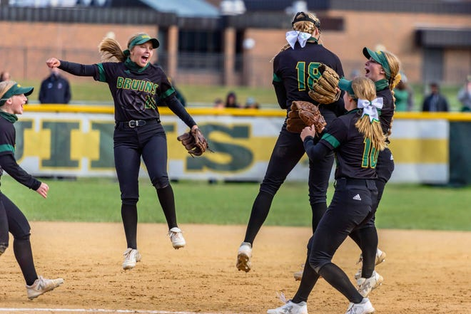 Rock Bridge infielders swarm pitcher Ella Schouten (18) after the final out of a Class 5 semifinal game against Marquette on Saturday at Rock Bridge High School.