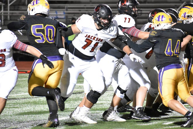 Jackson offensive lineman and Missouri football commit Connor Tollison (71) blocks during an Indians' extra-point attempt against Hickman on Friday night at Robert M. LeMone Field.