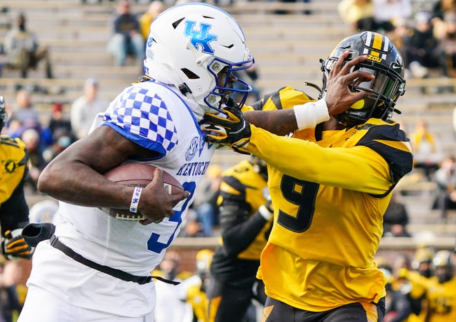 Kentucky quarterback Terry Wilson (3) moves the ball against Missouri safety Tyree Gillespie (9) during a game Saturday at Faurot Field.
