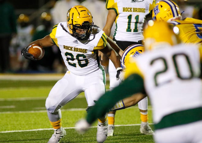 Rock Bridge's Bryce Jackson (26) carries the ball against Francis Howell during a game Friday night at Francis Howell High School.