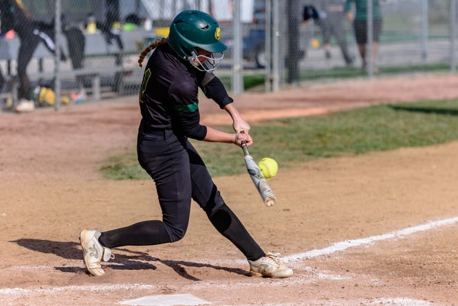 Rock Bridge's Margo Frossard (1) connects on a pitch during a Class 5 semifinal game against Marquette on Saturday at Rock Bridge High School.