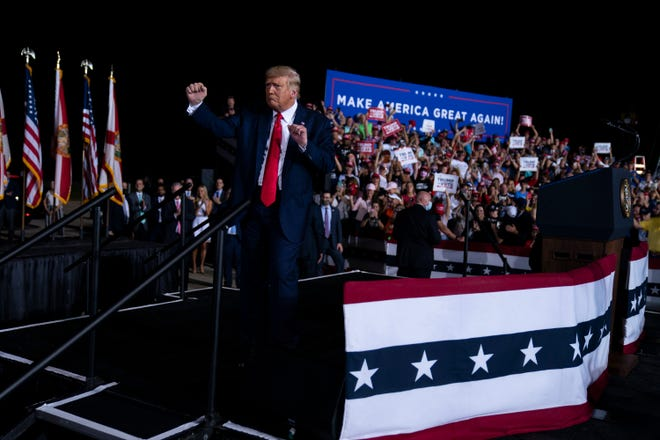 President Donald Trump dances Friday as he leaves a campaign rally at Pensacola International Airport in Florida.