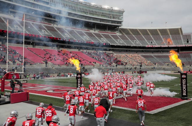 Ohio State players take the field in a nearly empty Ohio Stadium before Saturday's game against Nebraska.