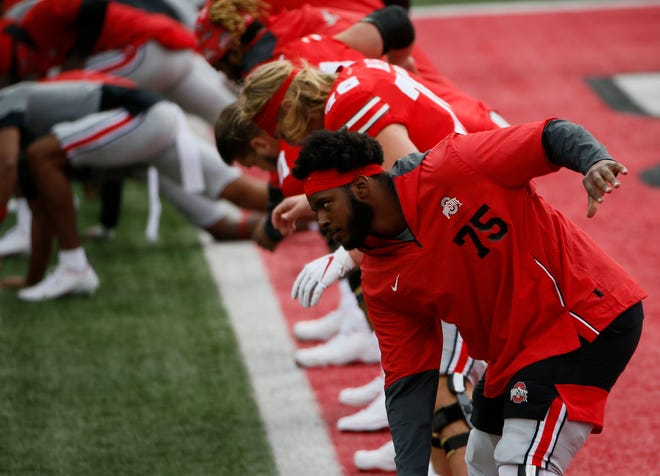 Ohio State offensive tackle Thayer Munford (75) warms up before Saturday's game between Ohio State and Nebraska.
