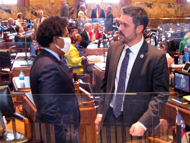 House Republican leader Blake Miguez, R-Erath, right speaks with Rep. Gary Carter, D-New Orleans, on the House floor on the final day of the special session on Oct. 23, 2020, in Baton Rouge.