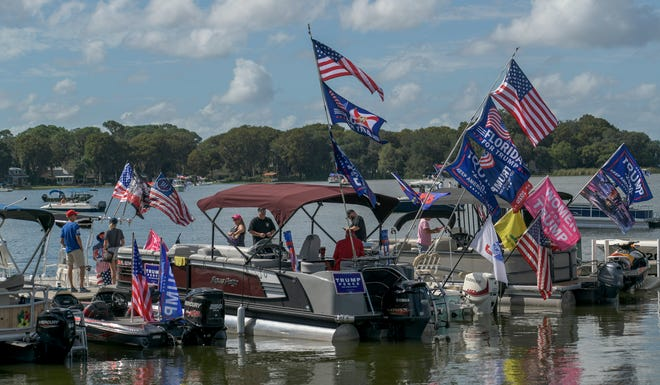 Boaters fly flags supporting President Donald Trump near Ferran Park in Eustis on Saturday