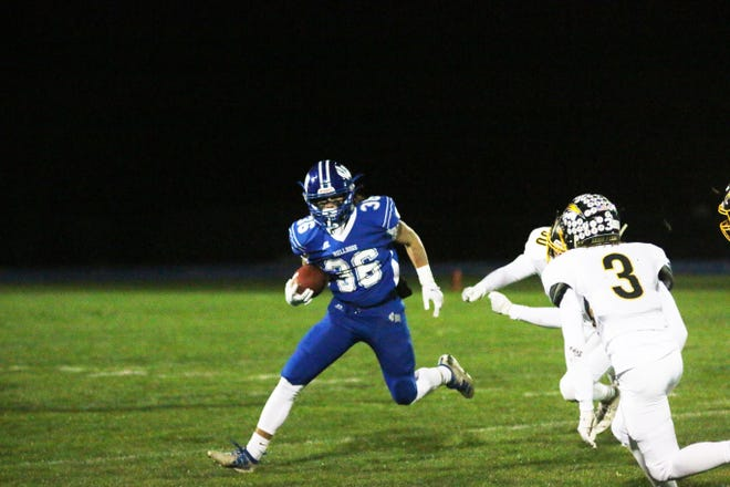 Van Meter's Dalten Van Pelt rushes against the ACGC defense on Friday, Oct. 23 in the second round of the Class 1A postseason.