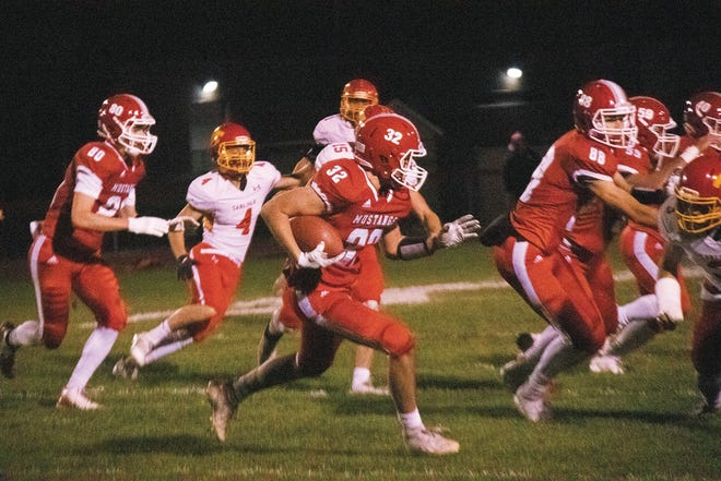 Ben Elfvin runs the ball for the Mustangs on Friday, Oct. 23.