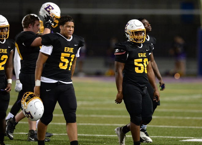 Erie High players walk off the field because of a lightning delay in the first quarter of the District 10, Region 9 game against McDowell on Oct. 23, 2020 at Erie Veterans Stadium in Erie.