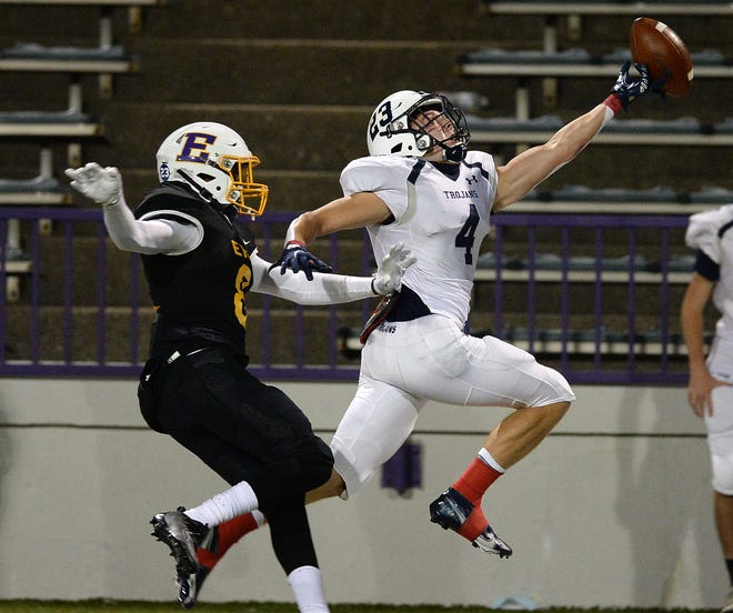 McDowell's Anthony Emling is unable to haul in a pass while defended by Erie High's Jamari Gilmore in the first quarter of the District 10, Region 9 game on Friday at Erie Veterans Stadium in Erie.