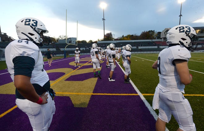McDowell football players warm up before their game against Erie High on Oct. 23, 2020 at Erie Veterans Stadium. The Trojans face the Royals in the District 10 Class 6A championship game Friday.