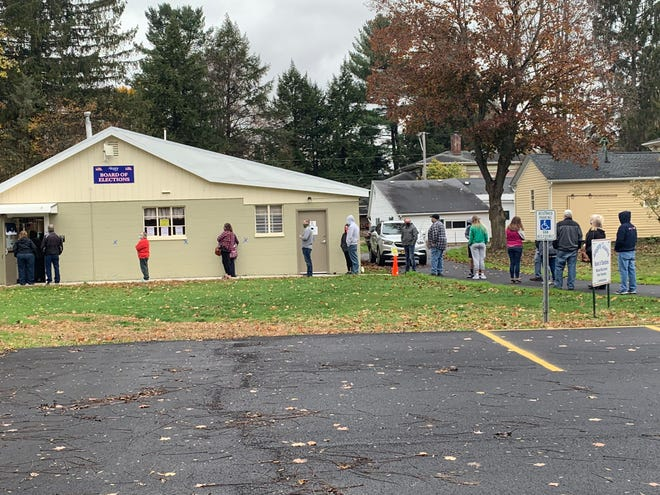 Voters line up outside the Allegany County Board of Elections at 8 Willets Ave. in Belmont Saturday as early voting kicked off across New York state.  In Steuben County, early voting is open at the Steuben County Annex, 20 E. Morris St. Early voting will continue until Nov. 3. Bring a mask and expect some lines.