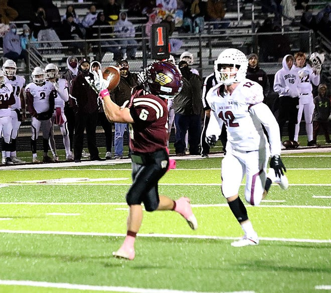 Whitesboro's Jacob Smith catches a touchdown pass after getting behind Bowie's Ryder Richey during District 4-3A (I) action.