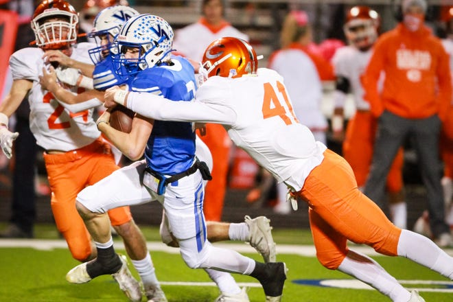 Van Alstyne's Gavin Montgomery is tackled by Celina's Hunter Neely in District 4-4A (II) action.