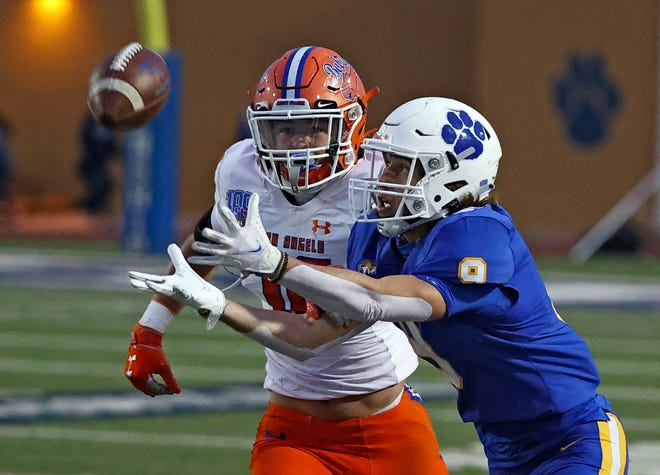 Frenship's Andrew Braddock (9) misses a pass around San Angelo Central's Ty Casey (10) during a District 2-6A game Friday against San Angelo Central at Peoples Bank Stadium in Wolfforth.