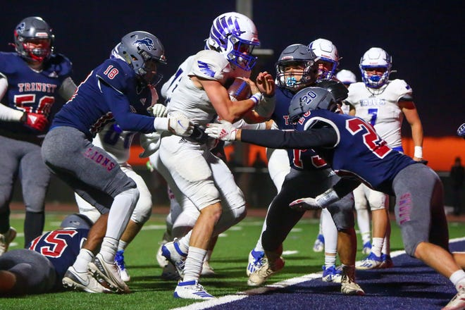 Lubbock Christian's Alex Lack (8) runs for a touchdown against Trinity Christian during a TAPPS Division III/IV, District 1 game Friday at Archie Warwick Memorial Stadium.