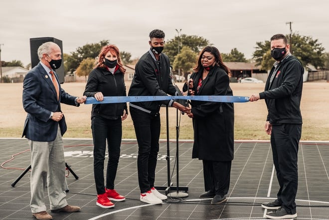 arrett Culver (center) cuts the ribbon to the Andre Emmett Dream Court built at Duran Park, which is located at 26th Street and Kewanee Avenue. The park is near the J.T. & Margaret Talkington Boys & Girls Club. From left to right: Lubbock mayor Dan Pope, Nancy Lieberman, Culver, Andre Emmett's mother Regina Oliver and Texas Tech men's basketball coach Chris Beard joined in on the court dedication.